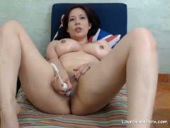 Busty brunette milf cumming hard in a hot webcam performance