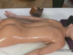 Slim redhead masseuse gives massage