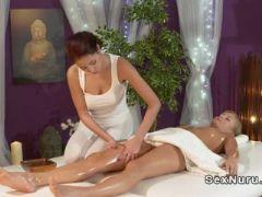 Redhead masseuse massages blondes clit