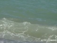 Natural tits and pussies in this beach spy video