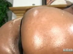 Ebony mum deep throats a cock
