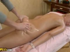 Golden haired beauty gets her pussy pumped from behind after a massage
