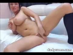 Sexy big tit brunette rides dildo and fucks toy