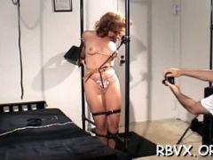 Bondage scene with a vibrator