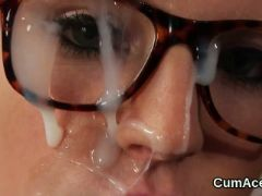 Horny babe gets cum shot on her face sucking all the jizm
