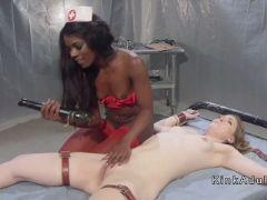 Ebony nurse fucks strapped blonde