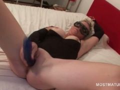 Masked blonde mature fucks herself with dildo