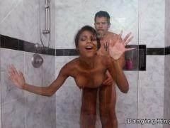 Ebony teen bangs huge dick in bathroom