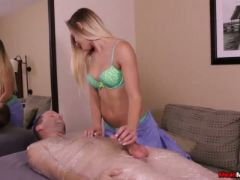 Cute massage therapist sits on jerks face